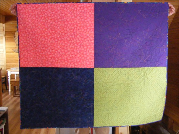 The back pieced with blue, purple, pink and green.
